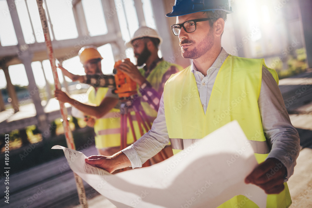 Fototapeta Picture of construction engineer working on building site
