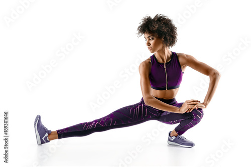 Athlete girl stretching her hamstrings Wallpaper Mural