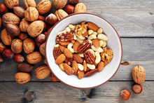 Bowl With Mixed Nuts On Wooden...