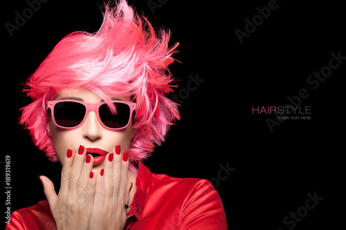 Beauty portrait of a woman with dyed pink hair