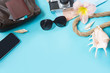 Travel set, sunglasses and summer accessories on blue background. Top view. Blank mock up for advertising or packaging.