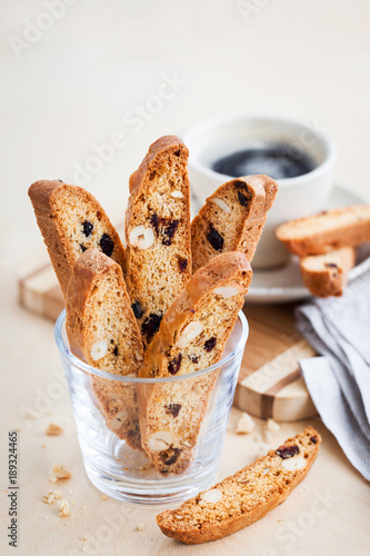 Cuadros en Lienzo Italian cranberry almond biscotti  and cup of coffee on background