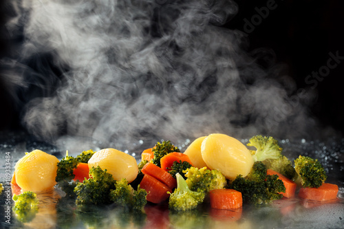Deurstickers Assortiment Steamed vegetables on tray.