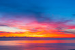 colorful sunset with calm sea and colorful clouds, seascape