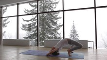 Little Child Girl Doing Gymnastics Exercises And Bridge Yoga Pose At The Gym On Mat