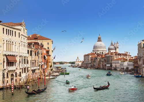 Poster Venise Venice, the Grand canal, the Cathedral of Santa Maria della Salute and gondolas with tourists