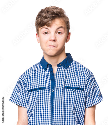 Teen boy making silly grimace - funny surprised face Canvas Print