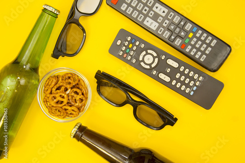 Photo  Weekend, Leisure, Lifestyle Concept with two TV remote controls, two pairs of 3d