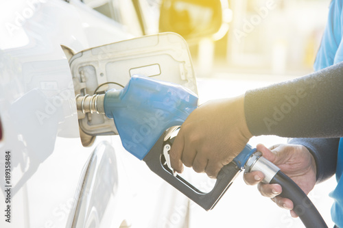 Fototapeta  Filling gas at the station