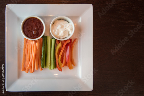Fresh carrot cucumber pepper and two sauce Canvas Print