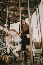 Young Woman In The Carousel Of...