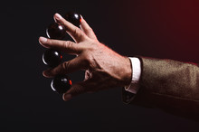 Magician Shows Trick With Magic Balls. Manipulation With Props. Sleight Of Hand.