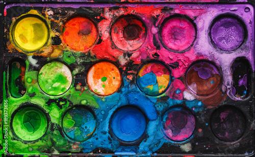 Fotografía Black watercolor palette with mixed bright colors