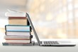 canvas print picture Stack of books with laptop
