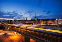 Scenic Night View Of Stockholm With Train And Light Trails. Riddarholmen And Gamla Stan At Night.