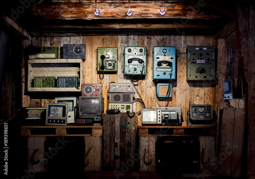 Retro devices on a wooden wall Canvas Print