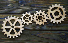 Gears On A Wooden Background. ...