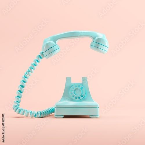 Obraz Blue vintage telephone on pink pastel color background. minimal idea concept. - fototapety do salonu