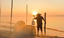 Fishermen Fishing In The Early Morning Golden Light,fisherman Fishing In The River,Thailand,Vietnam,myanmar,Laos,Asian Fisherman.