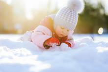 Small Child Crawls On Snow Aga...