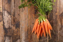 Fresh Carrot On Wood Background