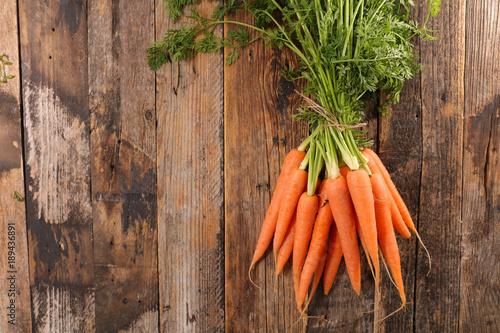Fotografie, Obraz fresh carrot on wood background