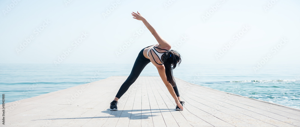 Fototapety, obrazy: Fitness Girl working out on the beach
