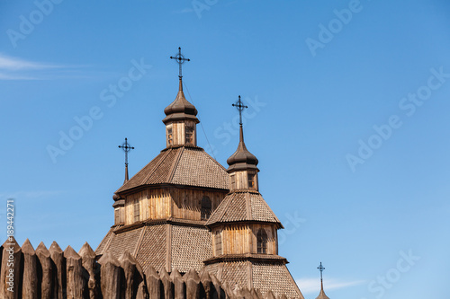 Fotografie, Obraz  Ancient wooden church and palisade