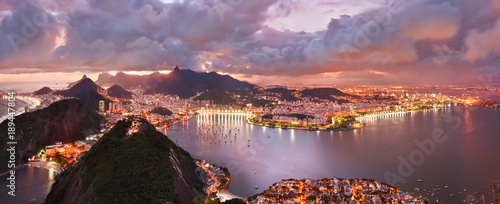 Spectacular aerial view over Rio de Janeiro at sunset. Viewed from mountain peak.