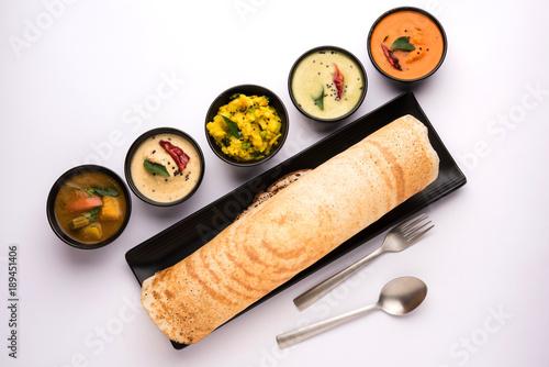 Masala dosa with chutney and sambar and potato sabzi. Cone, triangle or roll shape, selective focus