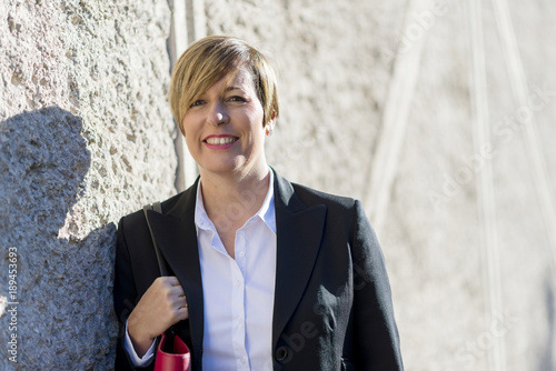 Fotografie, Obraz  Outdoor portrait of a beautiful lady on the street wearing formal clothes