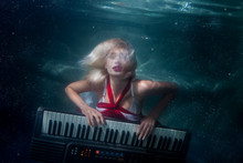 Woman Plays Music Diving Under...