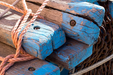 Wooden Plank With Fishing Net