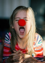 Girl With Clown Nose, Yawning,...