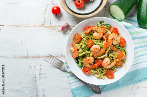 Zucchini noodles sauteed with cherry tomato and prawns
