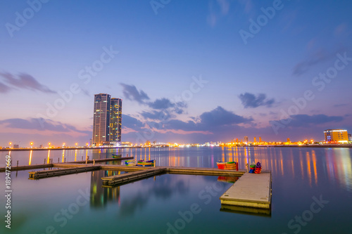 obraz dibond Ras Al Khaimah by night. View to beautiful bay with harbour in background