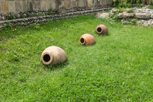 Old Clay Earthenware Pots In A...