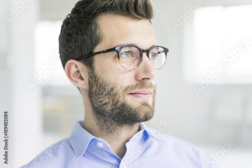Portrait of businessman looking sideways