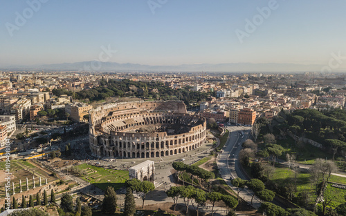 Fotografie, Obraz Aerial view of Colosseum at sunny day. Rome, Italy