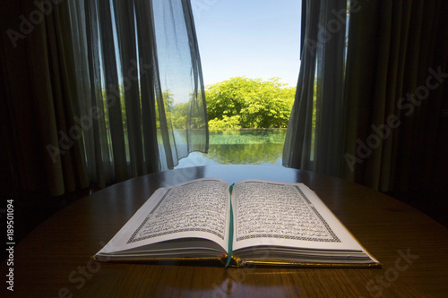 Open holy Koran book in the room