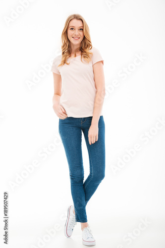 Pretty young woman standing isolated