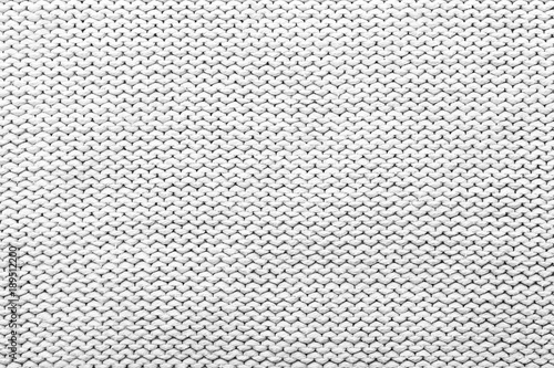 Fotobehang Stof White knitted fabric texture as background, closeup