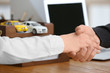 Insurance concept. Man and woman shaking hands over table, closeup