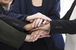 Group of business people stacked hand together , symbol of strong team work and sucess.
