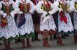 Leinwanddruck Bild - Polish folk dance group with traditional costume