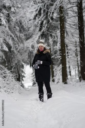 c9cb49d64b Pregnant woman a walk in winter landscape