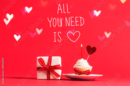 Photo  All You Need Is Love message with cupcake and heart ornament