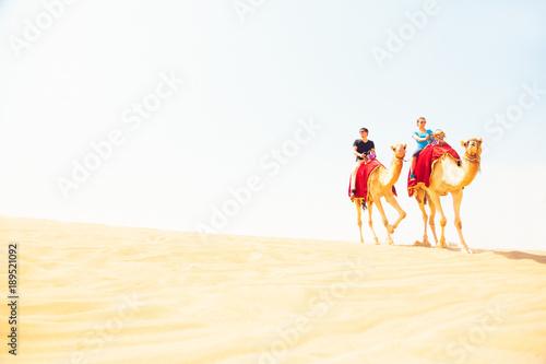 Photo  Tourists Riding Through The Desert