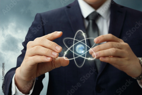 Atom shows in the hands of the businessman .