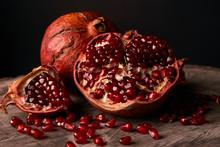 Ripe Pomegranate Fruit And Pomegranate Seeds